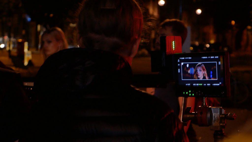 The monitor of the female model being filmed